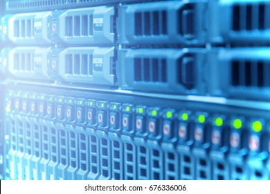 Hardware or array disk storage online in data center or server room with depth of field in blue tone , technology concept