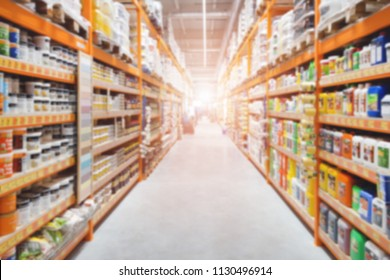 Hardware construction supermarket aisle and shelves. Perspective view of hypermarket rows with products. Blurred abstract shopping and trading background