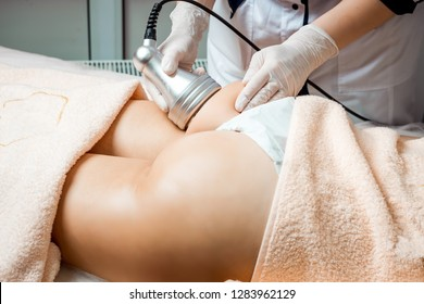 Hardware cosmetology. Body care. Spa treatment. Ultrasound cavitation body contouring treatment. Woman getting anti-cellulite and anti-fat therapy in beauty salon. Perfect shape buttocks