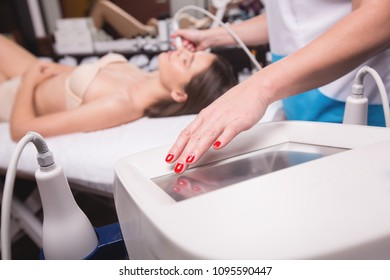 Hardware cosmetology. Closeup picture of happy young woman with closed eyes getting rf lifting procedure in a beauty salon