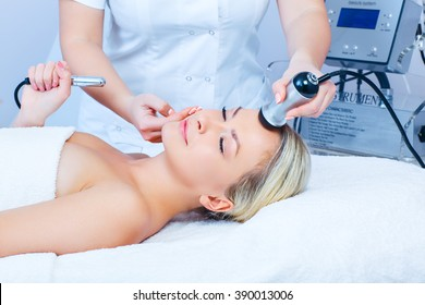 Hardware cosmetology. Closeup picture of happy young woman with closed eyes getting mesotherapy procedure in a beauty parlour.