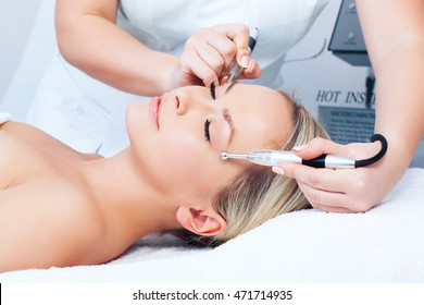 Hardware cosmetology. Closeup picture of lovely young woman with closed eyes getting rf lifting procedure in a 