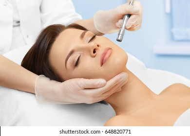 Hardware cosmetology. Spa clinic. Beautiful woman at skin treatment procedure. Microdermabrasion. Young healthy skin. Facial exfoliating. Skin rejuvenation. Beauty treatment. Cosmetology.