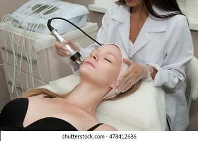 Hardware cosmetology. Young blonde woman getting rf lifting procedure in a beauty salon.