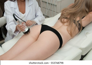 Hardware cosmetology. Young woman getting rf lifting procedure in a beauty salon.