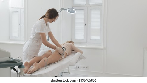 Hardware figure correction. Ultrasound cavitation body contouring treatment. Beautiful woman getting anti-cellulite and anti-fat therapy in beauty salon