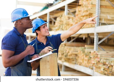 hardware store workers working in timber department