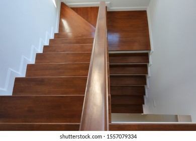 hardwood handrail banister on brown wooden stair interior decorated modern style of residential house