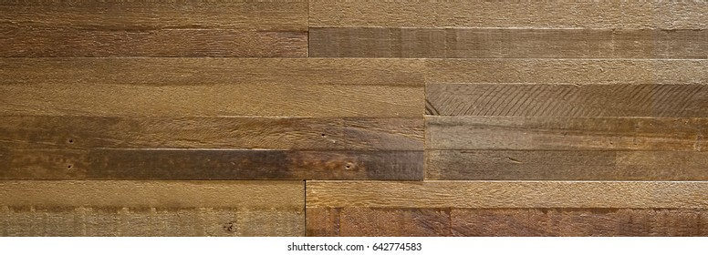 Hardwood reclaimed wood textured background. Blocks of vintage wood together to make a wall. Long surface for copy space.