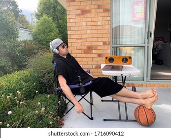 Hardworking man quarantined at home, chilled in the backyard