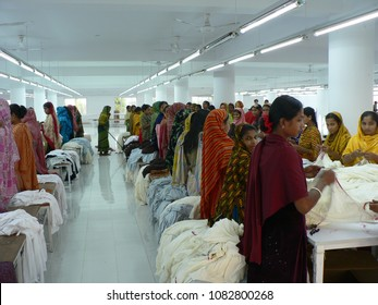Hardworking people in the textile factory Dhaka Bangladesh November 2007