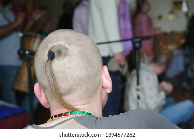 Hare Krishna sikha - a shaved head with a ponytail from the crown.