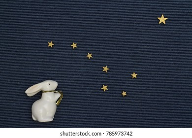hare looks at the starry sky, big dipper constellation, the flag of Alaska, flat lay