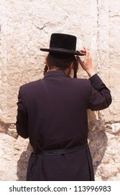 A Haredi Jew praying in front of the Western Wall in Jerusalem, Israel