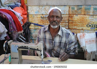 HARGEISA, SOMALIA - JANUARY 8, 2010: Tailor on the street of a city of Hargeisa. City in Somalia,  capital of  unrecognized state of Somaliland. Much of t he population lives in poverty.
