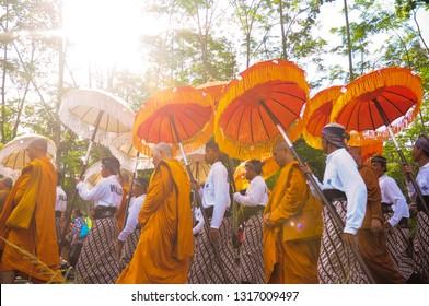 Hari Besar Waisak Magelang, Jawa Tengah-Indonesia. May, 14-2016. Monk and Buddhist walk from Mendut temple and bring holly water heading Borobudur temple to celebrate vesak day.