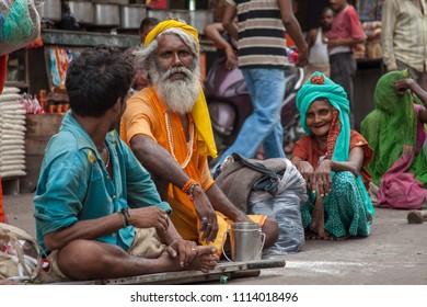 Haridwar, India, 10th August - A family of street beggars on the sidewalk n Haridwar, India.