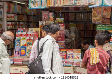 Haridwar, India, 19th August - Hindu pilgrims look at religious books in Haridwar, North India.