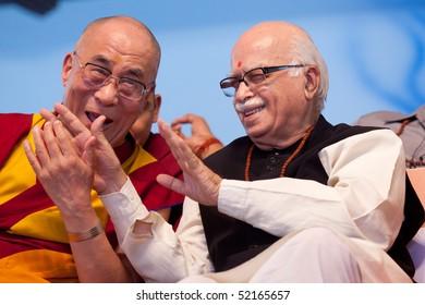 HARIDWAR, INDIA - APRIL 3: Dalai Lama and LK Advani laugh during an event at Kumbh Mela Festival April 3, 2010 in Haridwar, India.
