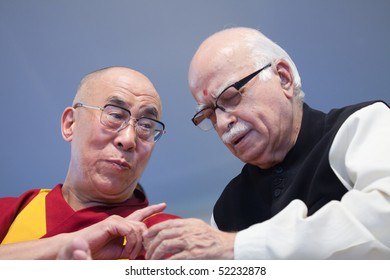 HARIDWAR, INDIA - APRIL 3: Dalai Lama (L) and LK Advani talk during an event at Kumbh Mela Festival April 3, 2010 in Haridwar, India.