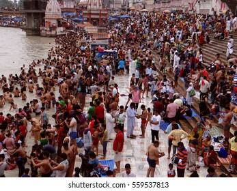 Haridwar, India - May 18, 2015: Pilgrims are taking holy bath in holy river Ganga at Haridwar to got salvation on occasion of a Hindu festival.