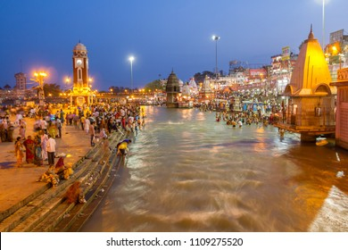 Haridwar, India,12th May 2013 -  Pilgrims on the ghats of Haridwar at night.