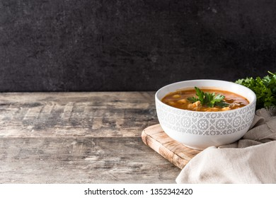 Harira soup in bowl on wooden table. Typical Moroccan food. Ramadán concept. Copyspace