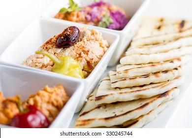 Harissa hummus, feta, ajvar and pita bread