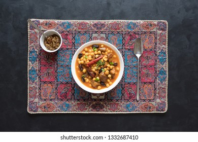 Harissa Lamb with chickpeas and apricots. Moroccan food.