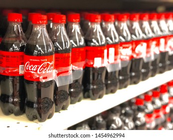 Harlan, KY / USA - July 17, 2019: Plastic bottles of soda are stacked on shelves at a local super market.