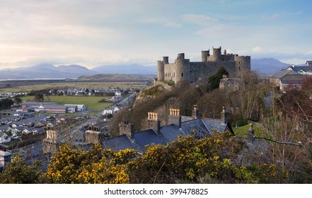Harlech Castle in Gwynned, Wales, photographed late on a spring evening. The hills of Snowdonia are visible in the background.