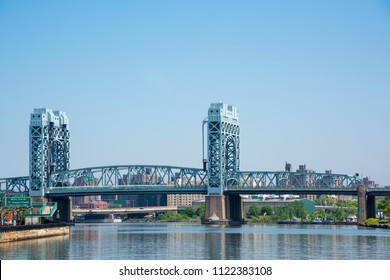 The Harlem River vertical - lift bridge is one part of the Triborough Bridge and connects Manhattan to Randall's Island in New York City. The Triborough bridge  is a complex of three separate bridges.