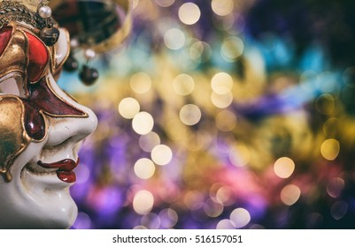 Harlequin carnival mask on colorful blur background