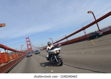 A Harley-Davidson motorcycle crossing the Golden Gate Bridge, San Francisco, California/United States of America,  February 21 - 2009