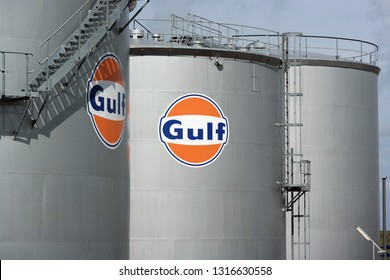HARLINGEN, NETHERLANDS - AUGUST 13, 2014:  Gulf logo at an oil storage tank, Gulf Oil LP is a major American oil company operating gas stations and refined petroleum terminals in Europe and the U.S.