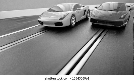 Harlow, England - March 06 2019: Slot cars racing on a slot car track, black and white for a retro look