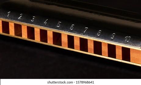 Harmonica. Close up. Macro on black background