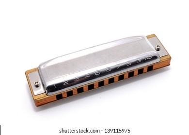 Harmonica, also French harp, blues harp, and mouth organ, isolated on white background. Is a free reed wind instrument used worldwide in blues, American folk  music, jazz, country, and rock and roll.