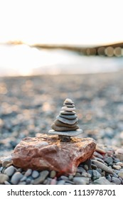Harmony and balance. Pyramid of the stones isolated on seaside background