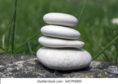 Harmony and balance, simple pebbles tower in the lawn, simplicity