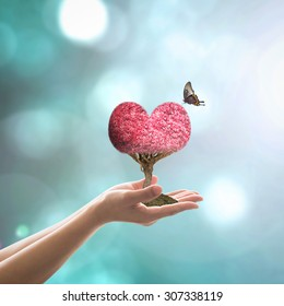 Harmony living environment, ecological friendly concept with red heart tree and butterfly