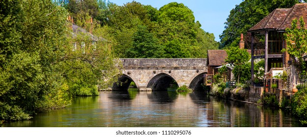 Harnham Bridge in Salisbury, across the River Avon, was built of stone by Robert de Bingham, Bishop of Salisbury in 1244.