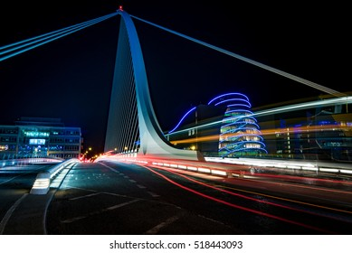 Harp bridge in Dublin with cars passing through by night