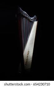 Harp instrument. Irish harp music isolated on black