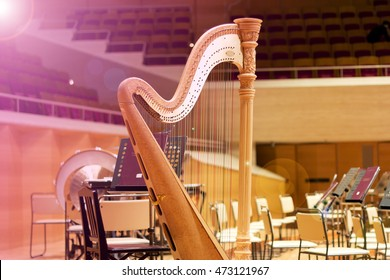 Harp in a large concert hall. Musical instrument.The concert harp