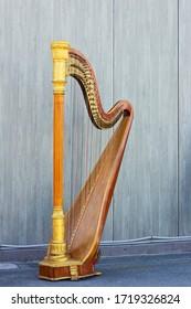 Harp on grey background. Musical instrument.