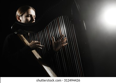 Harp player. Harpist with Musical Instrument Classical Musician playing classic music