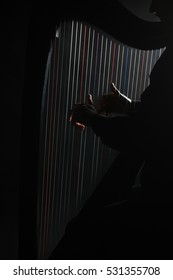 Harp strings closeup hands. Harpist with Classical Music Instrument Close up of harp player