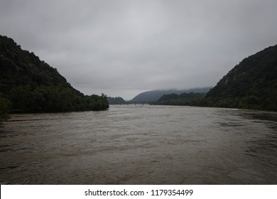 Harpers Ferry is a town that is listed on the National Register of Historic Places. It is located at the confluence of the Potomac and Shenandoah rivers and is surrounding by the Blue Ridge Mountains.