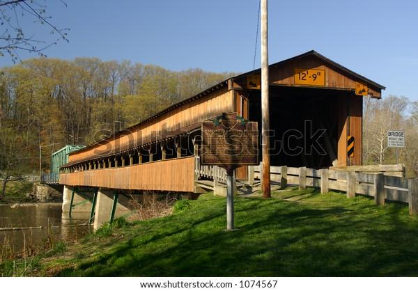 Harpersfield Bridge - Howe truss type - built 1868 - rebuilt 1992 - 228' long - longest covered bridge in OH - crosses Grand River - Ashtabula Co., OH